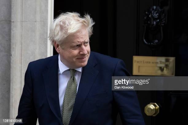 British Prime Minister Boris Johnson leaves 10 Downing Street to greet Iraq's Prime Minister Mustafa AlKadhimi on October 22 2020 in London England