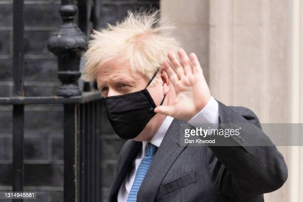 British Prime Minister Boris Johnson leaves 10 Downing Street to attend the weekly PMQ's April 28, 2021 in London, England. Johnson faces questions...