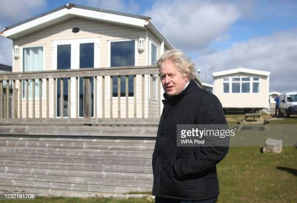 British Prime Minister Boris Johnson looks on during a visit to Haven Perran Sands Holiday Park on April 7, 2021 in Perranporth, England. The Prime...