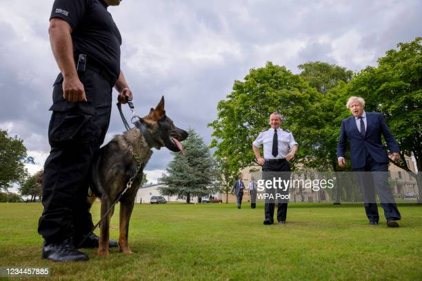 British Prime Minister Boris Johnson meets Chief Constable Iain Livingstone and dog handler PC Chris Morrison with dog Eli during a visit to the...