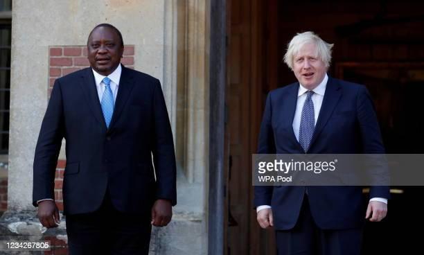 British Prime Minister Boris Johnson meets Kenya's President Uhuru Kenyatta at Chequers on July 28, 2021 in Aylesbury, England. President Uhura...