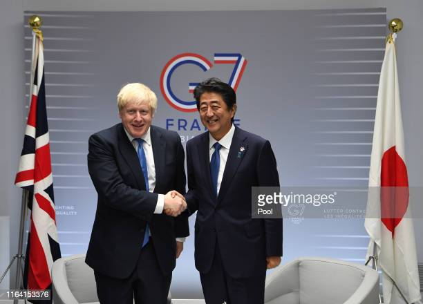 British Prime Minister Boris Johnson meets with Japanese Prime Minister Shinzo Abe on day three of the G7 Summit on August 26, 2019 in Biarritz,...