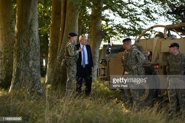 British Prime Minister Boris Johnson meets with military personnel on Salisbury plain training area on September 19 2019 in Salisbury England