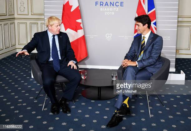 British Prime Minister Boris Johnson meets with Prime Minister of Canada Justin Trudeau ahead of a bilateral meeting on August 24 2019 in Biarritz...