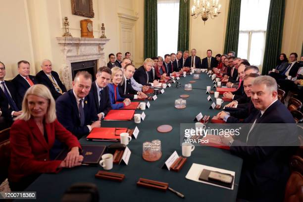 British Prime Minister Boris Johnson poses for a photograph during his first Cabinet meeting following a reshuffle at Downing Street on February 14...