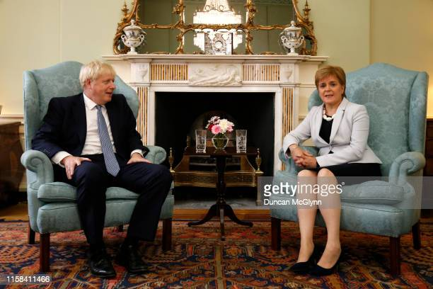 British Prime Minister Boris Johnson poses for a photograph with Scottish First Minister Nicola Sturgeon at Bute House on July 29 2019 in Edinburgh...