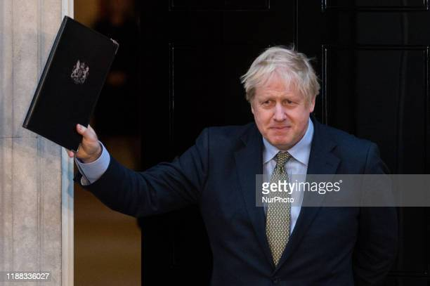 British Prime Minister Boris Johnson poses outside 10 Downing Street after making a speech following the Conservative Party's landslide victory in...