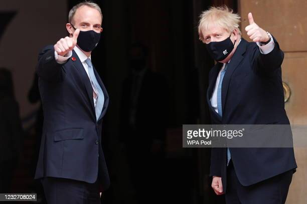 British Prime Minister Boris Johnson poses with Britain's Foreign Secretary Dominic Raab as he arrives for the G7 foreign ministers' meeting on May...