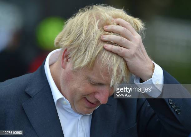 British Prime Minister Boris Johnson reacts as he speaks to local cyclists at the Canal Side Heritage Centre in Beeston on July 28 2020 in Beeston...