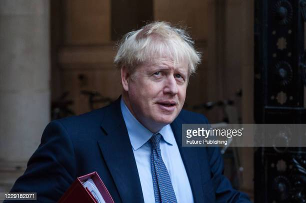 British Prime Minister Boris Johnson returns to Downing Street in central London after attending weekly Cabinet meeting at the Foreign Office on 20...