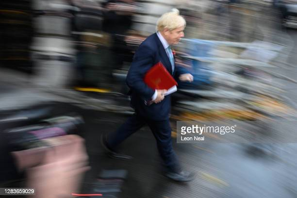 British Prime Minister Boris Johnson returns to number 10, Downing Street following the weekloy Cabinet meeting, on November 03, 2020 in London,...