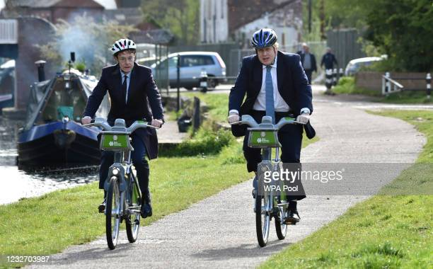 British Prime Minister Boris Johnson, right, and mayor for West Midlands Andy Street ride their bikes ride along the towpath of the Stourbridge canal...