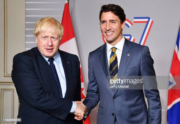 British Prime Minister Boris Johnson shakes hands with Prime Minister of Canada Justin Trudeau ahead of a bilateral meeting on August 24, 2019 in...