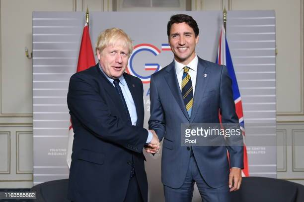 British Prime Minister Boris Johnson shakes hands with Prime Minister of Canada Justin Trudeau on August 24, 2019 in Biarritz, France. The French...