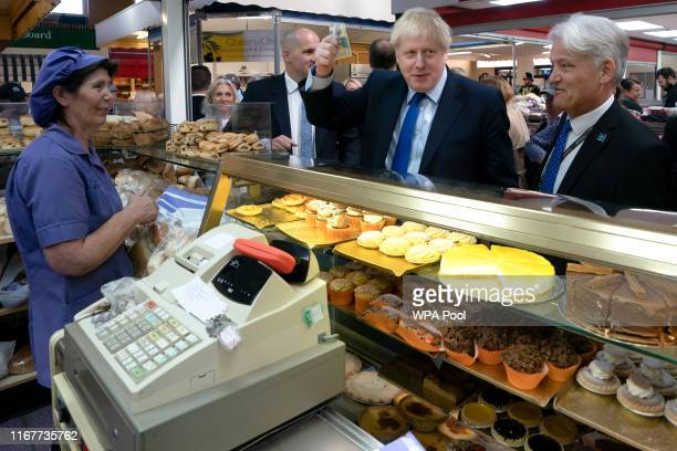 British Prime Minister Boris Johnson shops at a bakery during a visit to Doncaster Market on September 13 2019 in Doncaster England Officials say...