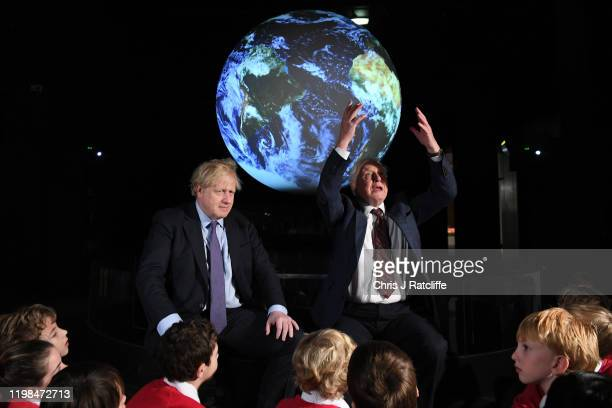 British Prime Minister Boris Johnson sits with Sir David Attenborough during the launch of the UKhosted COP26 UN Climate Summit which will take place...