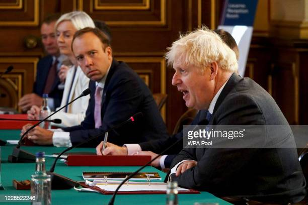 British Prime Minister Boris Johnson speaks as Secretary of State for Health and Social Care, Matt Hancock listens during a Cabinet Meeting at the...