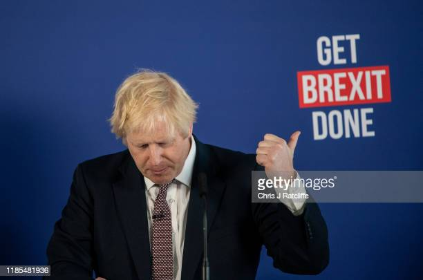 British Prime Minister Boris Johnson speaks at a press conference alongside cabinet minister Michael Gove and former Labour Party MP Gisela Stuart on...