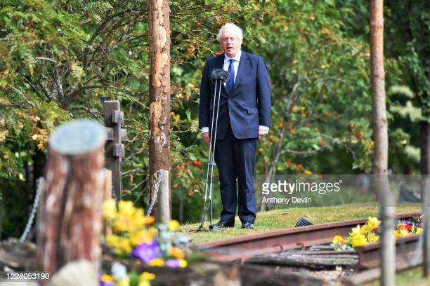 British Prime Minister Boris Johnson speaks during a national service of remembrance, marking the 75th anniversary of VJ Day, at the National...
