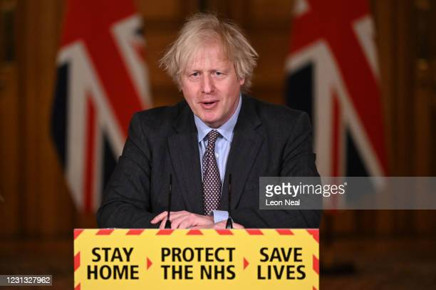 British Prime Minister Boris Johnson speaks during a televised press conference at 10 Downing Street on February 22, 2021 in London, England. The...