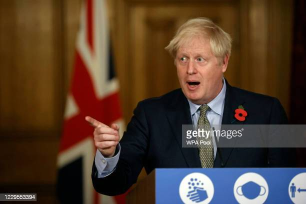 British Prime Minister Boris Johnson speaks during a virtual press conference at 10 Downing Street on November 9 2020 in London England