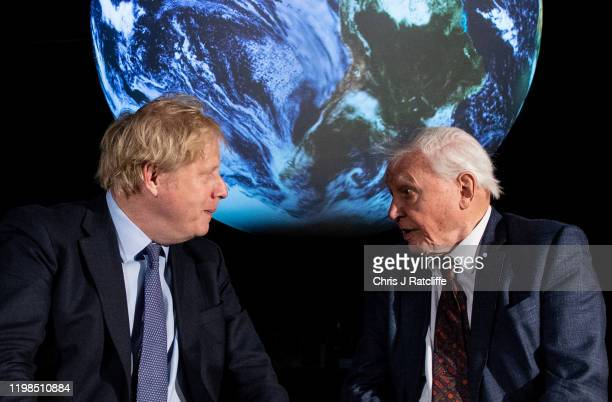 British Prime Minister Boris Johnson speaks with British broadcaster and naturalist Sir David Attenborough during the launch of the UKhosted COP26 UN...