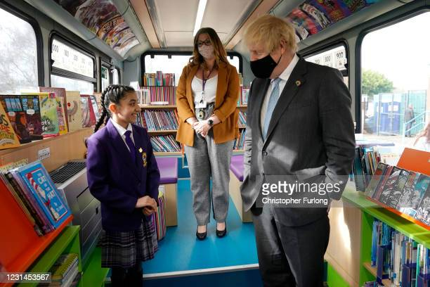 British Prime Minister Boris Johnson speaks with Head Girl Hirah Hussain on a bus library during a visit to St Mary's CE Primary School on March 1,...