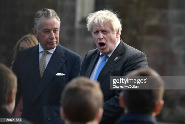 """British Prime Minister, Boris Johnson speaks with schoolchildren as he departs following a service of """"Reflection & Hope"""" to mark the centenary of..."""