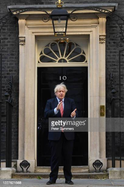 British Prime Minister Boris Johnson takes part in the weekly Clap for Our Carers event in Downing Street on May 28 2020 in London United Kingdom For...