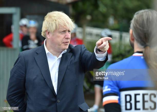 British Prime Minister Boris Johnson talks to cyclist Robert Cleave at the Canal Side Heritage Centre in Beeston on July 28 2020 in Beeston near...