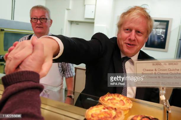 British Prime Minister Boris Johnson visits a bakery during a General Election campaign stop in Wells on November 14 2019 in Somerset England