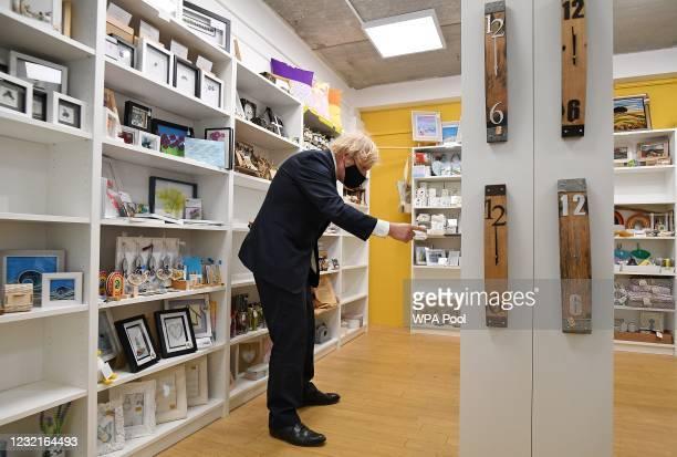 British Prime Minister Boris Johnson visits a shop inside Lemon Street Market on April 7, 2021 in Truro, England. The Prime Minister visited...