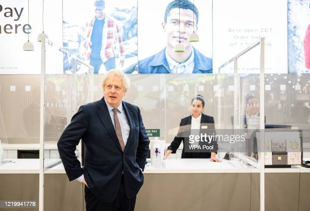 British Prime Minister Boris Johnson visits MS clothing department and other retail outlets in Westfield Stratford on June 14 2020 in London England...