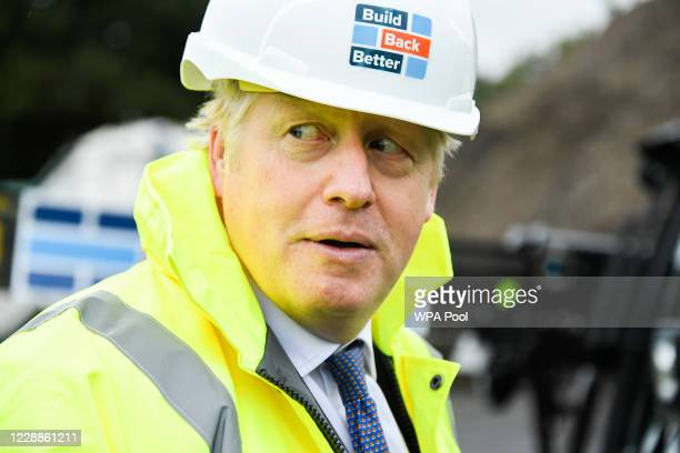 British Prime Minister Boris Johnson visits the Conway Heathrow Asphalt & Recycling Plant construction site in west London on October 3, 2020 in...