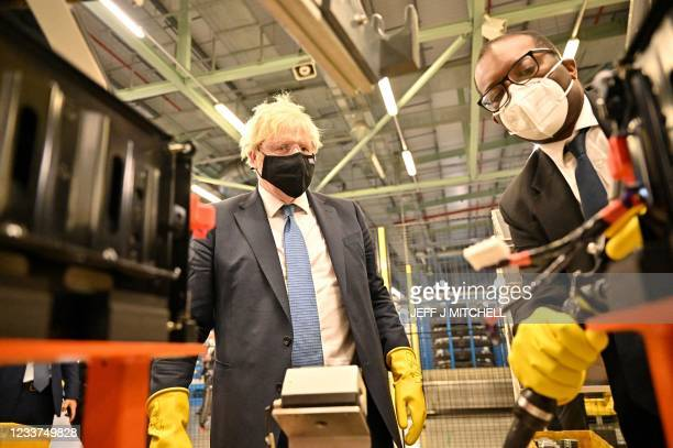 British Prime Minister Boris Johnson visits the Envision battery manufacturing facility at the Nissan production plant in Sunderland, north east...