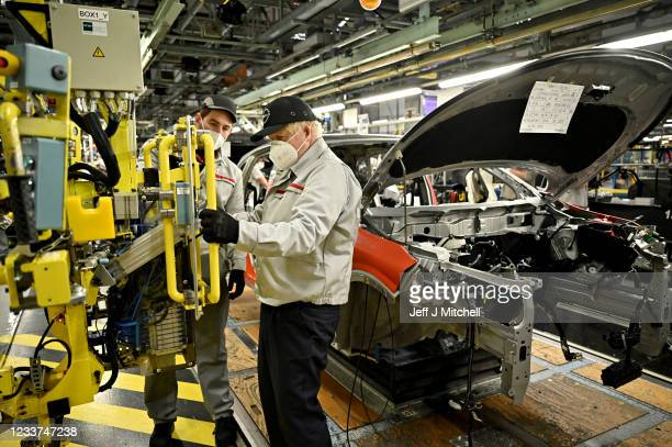 British Prime Minister Boris Johnson visits the Nissan Motor Co. Plant on July 1, 2021 in Sunderland, England. Nissan announces a huge increase in...
