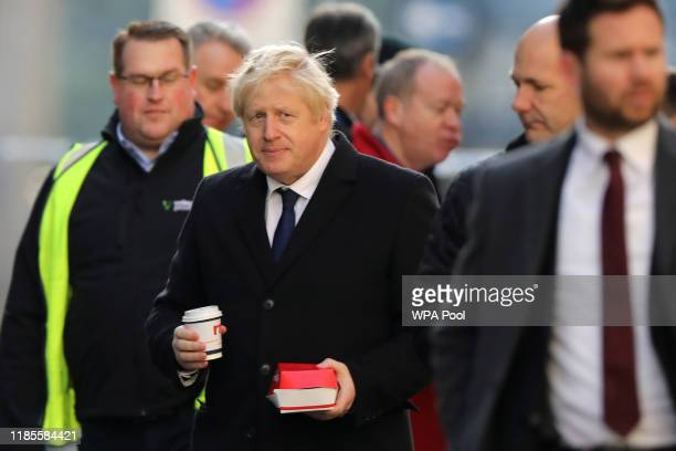 British Prime Minister Boris Johnson visits the scene of yesterday's London Bridge stabbing attack on November 30 2019 in London England A man and a...