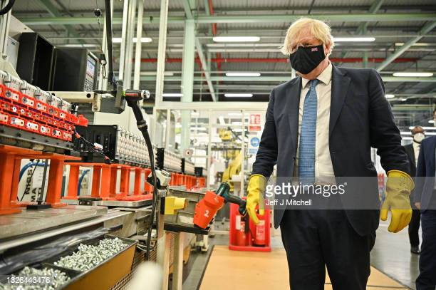 British Prime Minister Boris Johnson visits the the Envision AESC Holding Ltd. Battery manufacturing facility inside the Nissan Motor Co. Plant on...