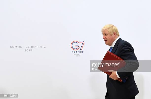 British Prime Minister Boris Johnson walks through the Bellevue hotel during the G7 summit on August 26 2019 in Biarritz France The French...