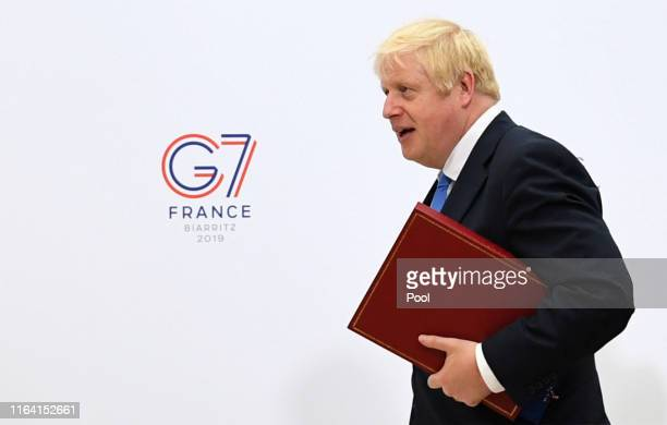 British Prime Minister Boris Johnson walks through the Bellevue hotel during the G7 summit on August 26, 2019 in Biarritz, France. The French...