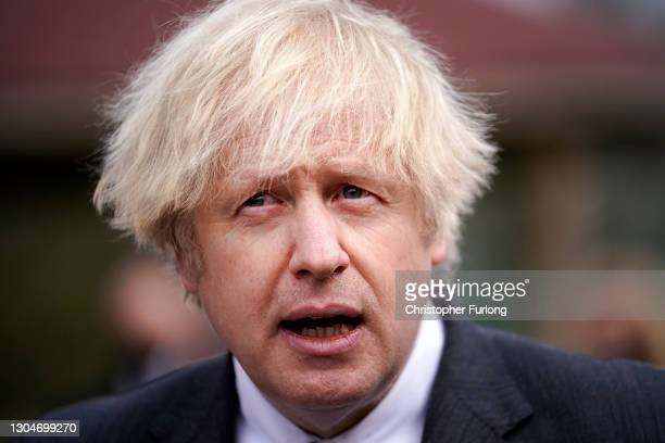 British Prime Minister Boris Johnson walks through the playground during a visit to St Mary's CE Primary School on March 1, 2021 in Stoke-on-Trent,...