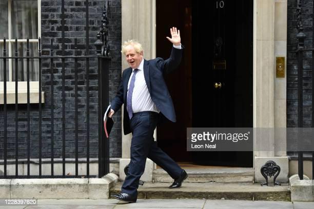 British Prime Minister Boris Johnson waves as he leaves Downing Street on September 8, 2020 in London, England.