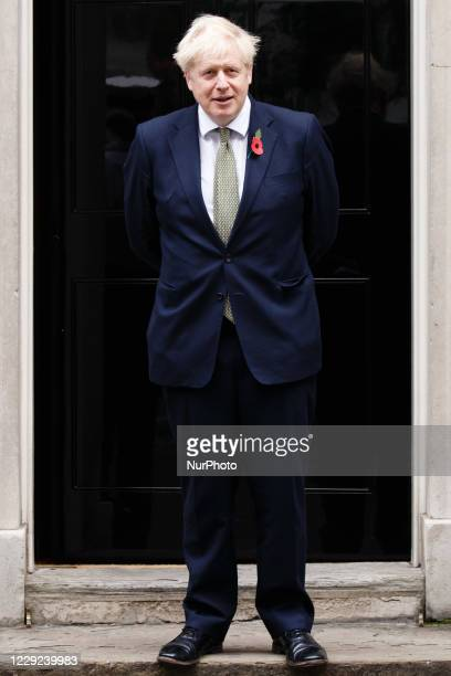 British Prime Minister Boris Johnson, wearing a remembrance poppy after welcoming service personnel and the director of fundraising for the Royal...