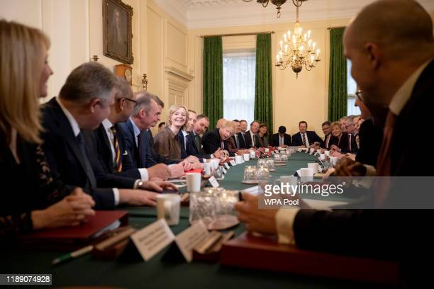 British Prime Minister Boris Johnson welcomes his new Secretary of State for Wales Simon Hart during his first cabinet meeting since the general...