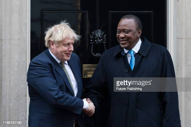 British Prime Minister Boris Johnson welcomes President Uhuru Kenyatta of Kenya on the steps of 10 Downing Street ahead of their meeting on 21...