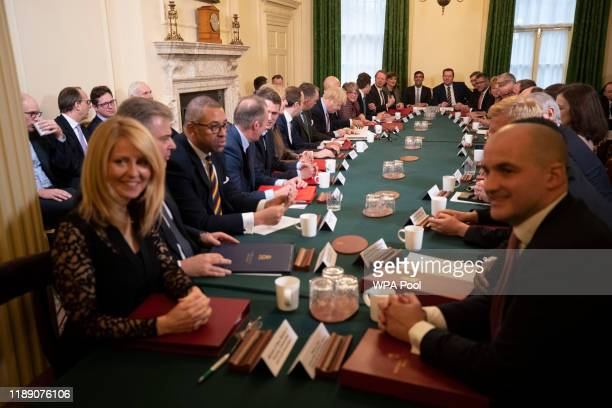 British Prime Minister Boris Johnson writes during his first cabinet meeting since the general election inside 10 Downing Street on December 17 2019...