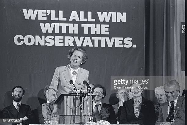 British prime minister candidate Margaret Thatcher speaks at a podium in an arena during the 1979 parliamentary election. Thatcher, representing the...