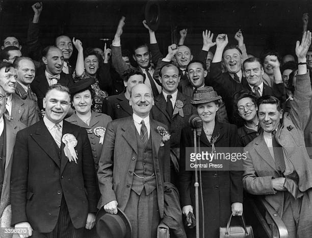 British Prime Minister Clement Attlee celebrates a Labour Party election victory with fellow MP WV Edwards and Mrs Attlee at Stepney in London