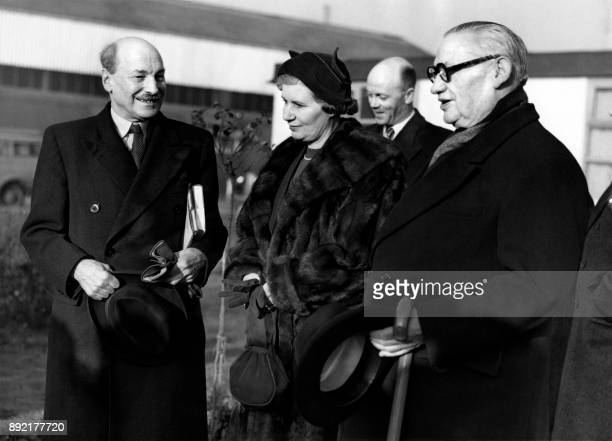 British Prime Minister Clement Attlee is welcomed by his wife Violet Attlee and Secretary of State for Foreign Affairs Ernest Bevin on his arrival at...