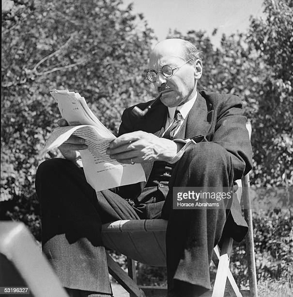 British Prime Minister Clement Attlee studies a document in the garden at his home in Stanmore Middlesex 28th July 1945